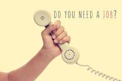 Telefonen och text behöver du ett jobb? med en retro effekt arkivfoto