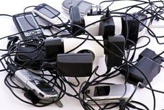Telefones e carregador de pilha Fotografia de Stock Royalty Free