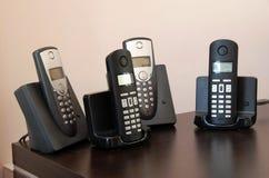 Telefones em suportes fotos de stock