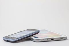 Telefones em um fundo branco Fotos de Stock