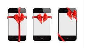 Telefones espertos com fitas vermelhas Imagem de Stock Royalty Free
