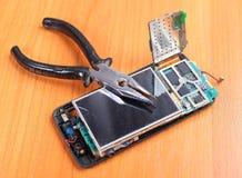 Telefones seguros do reparo Fotografia de Stock