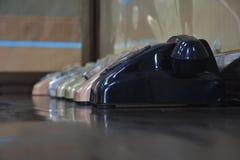Telefones velhos alinhados Imagem de Stock Royalty Free