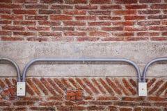 Telefonhåligheter på tegelstenväggen Royaltyfria Bilder