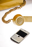 Telefoni antichi e mobili Immagine Stock