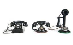 Telefoni antichi neri su una priorità bassa bianca Fotografia Stock Libera da Diritti