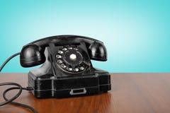 Telefoni d'annata - annerisca un retro telefono Fotografia Stock