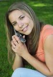 Telefoni la ragazza fotografia stock libera da diritti