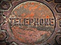 Telefoniczna Manhole pokrywa, obsady żelazo Zdjęcia Royalty Free