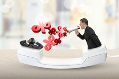Telefoniczny handset z biznesmenem wrzeszczy przy innym mężczyzna Fotografia Royalty Free