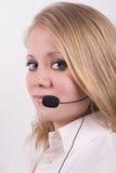 Telefonista de sexo femenino rubia, de ojos azules, profesional Imagenes de archivo