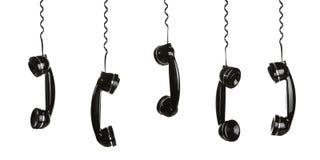 telefonlurar som hänger rad Arkivfoton