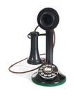Telefono antico nero su una priorità bassa bianca Fotografia Stock