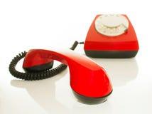 Telefono antiquato rosso - seli metta in contatto con concetto immagine stock libera da diritti