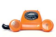 Telefono arancione fotografie stock