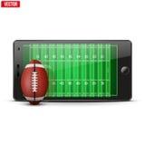 Telefono cellulare con la palla di calcio e campo sul Fotografia Stock