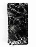 Telefono cellulare con lo schermo rotto fotografia stock libera da diritti