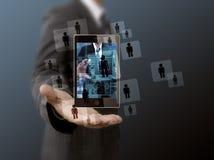 Telefono cellulare della tenuta dell'uomo d'affari Immagine Stock