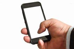 Telefono cellulare della tenuta della mano degli uomini con lo schermo in bianco facendo uso di una mano fotografia stock libera da diritti