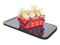 Telefono cellulare e cestino della spesa con le scatole Fotografie Stock