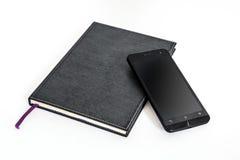 Telefono cellulare e taccuino semplici Fotografie Stock