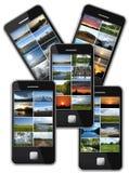 Telefono cellulare moderno con i molti foto dei paesaggi Fotografia Stock Libera da Diritti