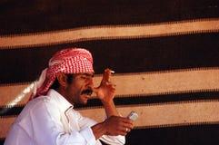 Telefono cellulare nel mondo arabo Fotografie Stock Libere da Diritti