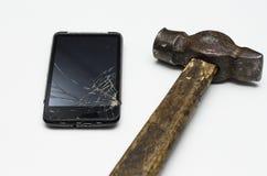 Telefono cellulare nero rotto Fotografia Stock