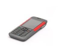 Telefono cellulare su priorità bassa bianca Fotografie Stock