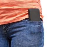 Telefono cellulare in una tasca delle blue jeans Isolato su priorità bassa bianca Fotografie Stock