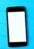 Telefono cellulare vuoto sulla tavola Immagini Stock