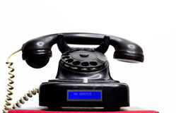 Telefono con fili fisso d'annata della terra con l'esposizione moderna dell'affissione a cristalli liquidi Fotografia Stock Libera da Diritti