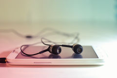Telefono con le cuffie Immagine Stock