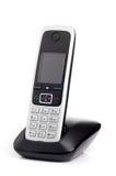 Telefono cordless su fondo bianco Immagini Stock