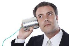 Telefono del barattolo di latta e dell'uomo d'affari Fotografia Stock Libera da Diritti