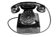 Telefono dell'annata isolato nella priorità bassa bianca Fotografia Stock