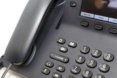 Telefono dell'ufficio nel fondo bianco Fotografia Stock Libera da Diritti