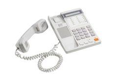 Telefono della linea terrestre con il quadrante del pulsante su un fondo leggero immagine stock