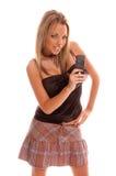 Telefono della macchina fotografica della ragazza di fascino Fotografie Stock