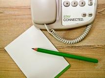Telefono della matita e rilievo di nota fotografie stock libere da diritti