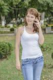 Telefono della ragazza Fotografie Stock Libere da Diritti