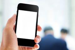 Telefono della tenuta della mano Immagine Stock Libera da Diritti
