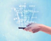 Telefono della tenuta della mano con i numeri digitali Immagine Stock