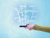 Telefono della tenuta della mano con i numeri digitali Fotografie Stock Libere da Diritti