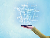 Telefono della tenuta della mano con i numeri digitali Immagini Stock Libere da Diritti