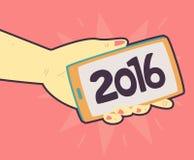 Telefono della tenuta della mano con un nuovo anno 2016 sullo schermo Immagine Stock