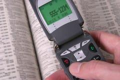 Telefono delle cellule e guida telefonica Fotografie Stock Libere da Diritti