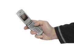 Telefono delle cellule in una mano 1 fotografia stock