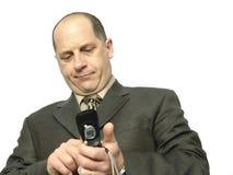 Telefono di composizione dell'uomo d'affari fotografia stock
