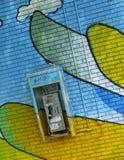 Telefono di paga dei graffiti Fotografia Stock
